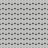 与小点和三角的无缝的样式 库存照片