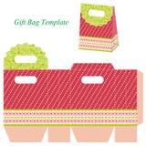 与小点和丝带的红色礼物袋子模板 图库摄影