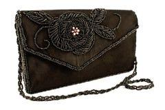 与小珠的黑色女性袋子 库存图片