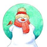 与小的鸟的雪人 免版税库存照片