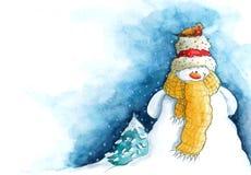 与小的鸟的雪人 库存照片