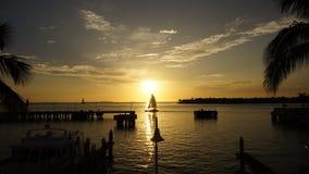 与小船的基韦斯特岛日落 库存图片