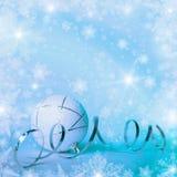 与小装饰品和雪花的圣诞节背景 图库摄影
