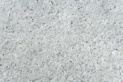 与小黑光点图形的浅灰色的水泥地板 免版税库存照片