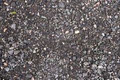 与岩石背景纹理closup的黑和灰色沥青 图库摄影