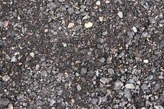 与岩石背景纹理closup的黑和灰色沥青 免版税库存照片