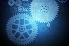 与嵌齿轮轮子的抽象蓝色背景 库存照片