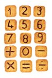 与巧克力数字的方形的曲奇饼在他们在白色背景隔绝了 从零的图到九 库存照片