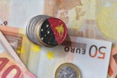 与巴布亚新几内亚的国旗的欧洲硬币欧洲金钱钞票背景的 免版税库存照片