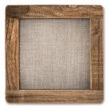 与帆布的葡萄酒土气木制框架在白色 库存照片