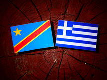 与希腊旗子的刚果民主共和国旗子在树 图库摄影