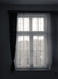 与帷幕的老窗口 库存照片