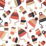 与帽子和手套的无缝的传染媒介背景 有被编织的冬季衣服的样式瓦片在红色和蓝色 冬天穿戴设计, 向量例证