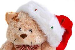 与帽子的逗人喜爱的圣诞节长毛绒熊 免版税库存图片