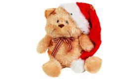 与帽子2的逗人喜爱的圣诞节长毛绒熊 免版税库存图片