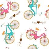 与平的减速火箭的自行车的无缝的样式男孩和女孩的 免版税库存照片
