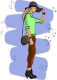 与年轻女人的时尚剪影帽子的 免版税图库摄影