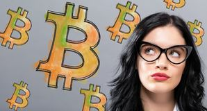 与年轻女实业家的Bitcoin 免版税库存照片