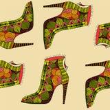 与幻想样式鞋子的无缝的背景 免版税库存图片