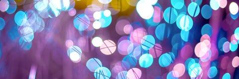 与幻想氖纹理的抽象背景 生日和欢乐背景趋向在颜色紫外金子的颜色 图库摄影