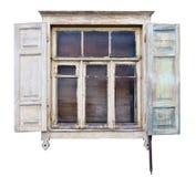 与开放窗帘的奇怪的被毁坏的白色窗口在木头 免版税库存图片