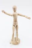 与开放胳膊的一个木时装模特 库存照片