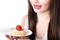 与开胃蛋糕的女性模型 库存图片