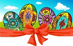与弓和被绘的鸡蛋的复活节横幅 图库摄影