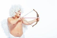 与弓摆在的一点天使 图库摄影
