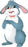 与弓的复活节兔子 库存图片