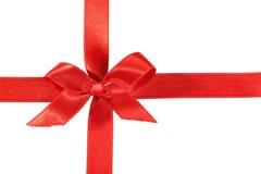 与弓的红色丝带在白色背景 免版税图库摄影