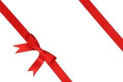 与弓的红色丝带在白色背景 库存图片