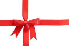 与弓的红色丝带在白色背景 免版税库存图片