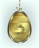 与弓的金黄复活节彩蛋 免版税图库摄影