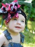 与弓的婴孩面孔 库存照片