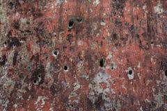 与弹孔的墙壁表面 免版税库存图片