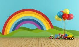 与彩虹和玩具的空的游戏室 免版税库存图片