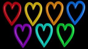 与彩虹心脏的逗人喜爱的动画在黑背景 股票录像
