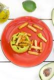 与微型grissini,静物画的鲕梨Hummus 库存图片
