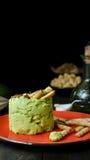 与微型grissini,静物画的鲕梨Hummus 图库摄影