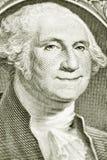 与微笑的乔治・华盛顿的一美金 免版税图库摄影