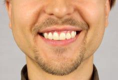 与微笑的男性嘴 库存图片
