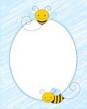 与微笑的蜂的卵形蓝色框架 库存图片