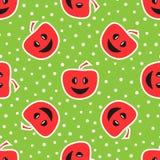 与微笑的面孔的滑稽的苹果 无缝五颜六色的模式 红色, 库存照片