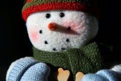 与微笑的面孔的闪烁的雪人特写镜头 免版税库存图片