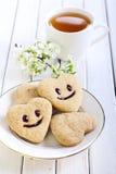 与微笑的饼干 图库摄影