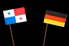 与德国旗子的巴拿马旗子在黑色 免版税图库摄影