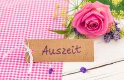 与德国词, Auszeit,作为礼物的手段暂停的卡片为华伦泰或母亲节 免版税库存图片
