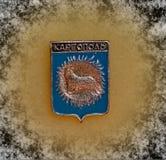 与徽章的徽章卡尔戈波雷,阿尔汉格尔斯克的从苏联的系列'城市的地区' 特写镜头 Faleristics 免版税库存照片