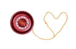 与心形的麻线的红色溜溜球 免版税图库摄影